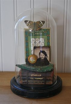 Vignette under glass dome by Paula Cheney/One Lucky Day. Shakespeare, flower frog, vintage button card and photo.