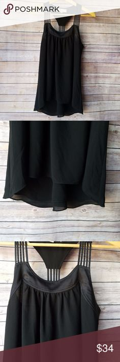"""Lost April Anthropologie Black Silky Strapy Tank Lost April Anthropologie Womens Black Silky Strapy Classic Racerback Tank Top S   Excellent used condition- no rips, stains, smoke free home. Pit to pit: 16.5"""" Shoulder to hem: 24.5"""" Anthropologie Tops Blouses"""