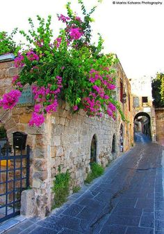 small streets and beatiful flowers I wanna come back.  old town, rhodos