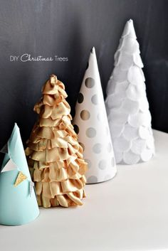 Paper, Fabric and Felt Trees: These cone trees look cool grouped together when mixed with pattern and texture. Find more easy, rustic, and cool DIY Christmas craft ideas that can decorate your home this Christmas here.