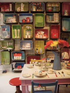Cath Kidston Store in New York - with less color also a book storage idea