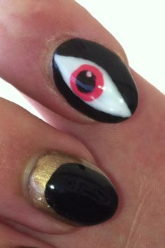 Inspirational photo by Brian  Allen. Evil Eye Shellac design using Tropix for the iris, studio white, & black pool. Sugared Spice on the lanula area #cnd #shellac #evileye #beauty #trendy #creative #tropical #tropix #eye #design #red #coral #nailart #naildesign #nailartist #nails #fall @Bloom.com