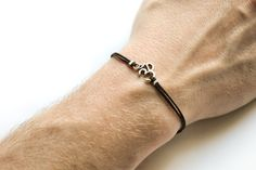 OM bracelet, men's bracelet with Tibetan silver Om charm, Hindu, black cord, bracelet for men, gift for him, yoga bracelet, groomsman gift by Principles on Etsy https://www.etsy.com/listing/187786455/om-bracelet-mens-bracelet-with-tibetan