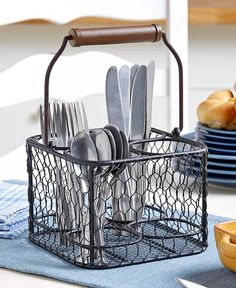 Make sure all your family members and guests have everything they need to eat with this Chicken Wire Flatware Caddy. It features 4 separate compartments for sorting flatware, napkins and more. A handl