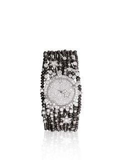 CHANEL WATCH IN 18K WHITE GOLD, BLACK DIAMONDS AND DIAMONDS. More and more is more...