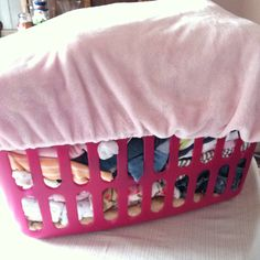 Put the changing pad cover over laundry basket when carrying to or from laundry area..... If it tips over, who cares?