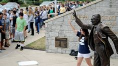 People flocked to the Joe Paterno statue outside of Beaver Stadium on Friday, July 20, 2012, after rumors that the statue will be taken down this weekend. Abby Drey CENTRE DAILY TIMES