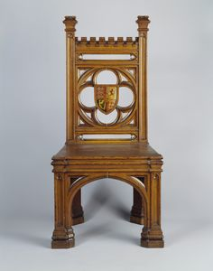A set of oak side chairs with a dentilled top rail, rectangular back pierced with a quatrefoil centred by a painted royal coat of arms, solid seat on panelled square carved legs with pierced arcaded spandrels. Regency Furniture, Gothic Furniture, Antique Furniture, Gothic Chair, Royal Collection Trust, Antique Chairs, Medieval Art, Cabinet Makers, Quatrefoil