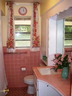 White Trim and Vintage Curtains. Oh so chic!  Cottage by the Sea: Pink Bathrooms