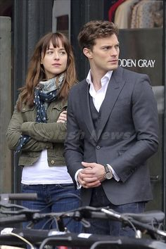 Jamie Dornan saves Dakota Johnson from being hit by  a bike on the set of 'Fifty Shades of Grey'