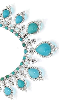 A turquoise and diamond necklace and earclips, circa 1960 designed as a line of round cabochon turquoise accentuated by round brilliant-cut diamond cluster spacers and suspending a graduated fringe of pear-shaped cabochon turquoise, pear and round brilliant-cut diamonds; a pair of pendant earclips en suite; estimated total diamond weight: 40.00 carats; mounted in platinum; length of necklace: 13in.