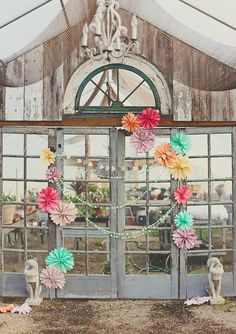 Wedding Photo Booth Ideas Re-use the pinwheels from the ceremony and make garland