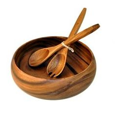 """Acacia wood bowl with serving utensils.       Product: 1 Bowl and 2 serving utensils    Construction Material: Acacia   Color: Natural           Dimensions:    Bowl: 10"""" Diameter  Utensils: 12"""" W eachCleaning and Care: Wash with warm soapy water and air dry"""