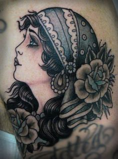 Gypsy head black and white traditional tattoo. I love the use of subtle blues. They make this so beautiful.