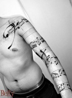 Music, arm/  (upper arm, empty staff...idea?)