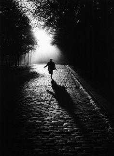 Sabine Weiss, Paris 1953  i don't know what he's running from buti like the light and shadow cast