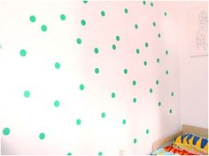 Fun DIY polka dots...contact paper and a large hole punch + a wall ....easy on, and off. Fun for a kids room wall. Would be great in a kitchen too I suppose.
