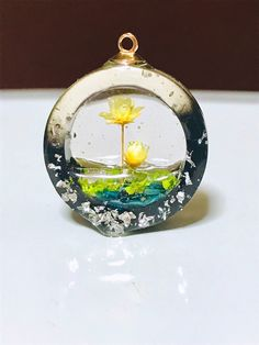 I would make a Winchime out of this (adding a hardener to this medium) and add beautiful live succulents sealing each - Salvabrani Diy Resin Crafts, Polymer Clay Crafts, Diy And Crafts, Uv Resin, Resin Art, Resin Jewelry, Jewelry Crafts, Jewellery, Kawaii Jewelry