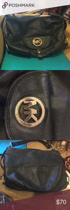 Black Leather Michael Kors Black Leather Michael Kors! Gold Michael Kors emblem has some scratches (shown in pictures) leather and interior is in good shape!!! Back of purse has a pocket and interior has several pockets, including zip pocket! Michael Kors Bags