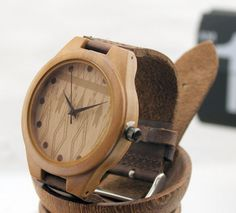 The bamboo wooden watch is equipped with high quality Japan quartz movement. Diameter of the dial 1.7 inches. Strap is made of genuine leather. •