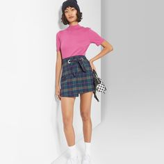 97589898e Corduroy mini skirt in pink. Wrap-design finished with four front buttons.  Elastic waist at the back for easy comfortable wear. Soft breatha…
