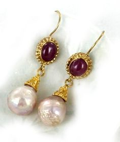 Pink pearls are said to be the symbol of Love! We lovingly paired our solid 18K Gold and ruby handmade one of a kind earwires with these gorgeous 10mm baroque Pink Pearls to create an elegant one of a