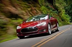 Tesla Model S - all-electric sedan with a 300-mile range, 0-60 in 5.6 seconds, and HOT