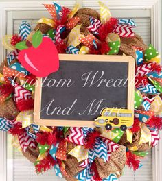 Adorable classroom decor wreath. Burlap mesh wreath with red chevron ribbon, teal chevron ribbon, yellow chevron ribbon, polka dot ribbon