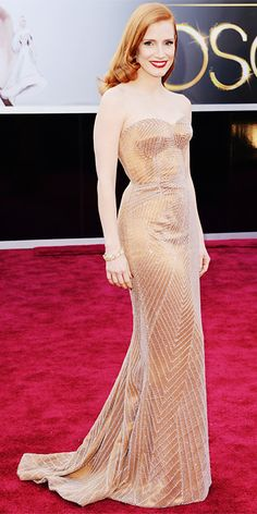 The Academy Awards 2013: Jessica Chastain in a Giorgio Armani strapless gown and Harry Winston earrings.