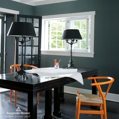 Benjamin Moore Knoxville Gray (HC-160) | Create contrast with traditional yet on-trend grey green. This refined office provides a calming, light-filled space to get down to business. Playful orange Wegner Wishbone chairs pop against walls painted in Benjamin Moore's Knoxville Gray (HC-160). #paint