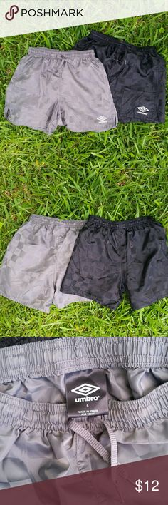Umbro soccer shorts Two pairs of small Umbro soccer shorts. 100% Nylon. Used in good condition with minor signs of wear: emblem slightly faded from dryer.  No major defects, No stains or holes.   **Bundle and Save Umbro Bottoms Shorts