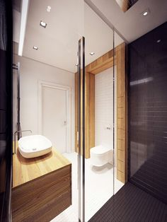 A Lively Contemporary Apartment Building, Well Decorated and Comfortable : The Bathroom Design Black Mosaic Tile Glass Shower Door Floating Wood Vanity White Sink Faucet Toilet And Door