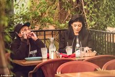 Tyga looks bored as girlfriend Kylie Jenner is distracted by her phone #dailymail