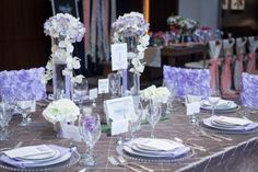 Silver and purple #wedding inspiration from the Nashville PWG Wedding Show! Love the incorporation of orchids in the #centerpieces.