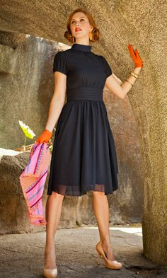 Short puff sleeved chiffon dress with mock collar  Available in deep navy blue Ruched, banded waist flows out into a full a-line skirt