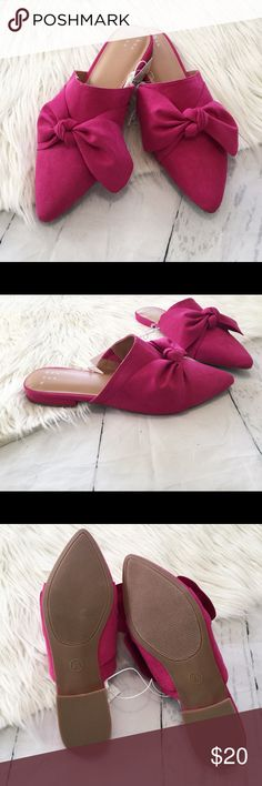 A New Day Rhea Hot Pink Backless Mules You'll look pretty in pink anywhere you go flaunting these Rhea Backless Loafer Mules. These pointed-toe mules come in a bright shade of pink to add a pep in your step no matter where you're off to. A knotted bow enhances the feminine flair while the low block heels make them easy and comfortable to walk in. Pair with a little black dress for an extra pop of color, or give a simple jeans-and-tee look an extra dose of fashion-forward edge.  **Size 8 1/2…
