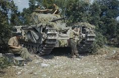 CHURCHILL TANKS IN ITALY, JULY 1944.   A Churchill Tank, possibly of the 51st Royal Tank Regiment, is given a final check in a harbour area of Italy.