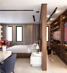 Dependendo do formato do quarto, é possível com a utilização de uma divisória de madeira, criar um closet mais reservado.