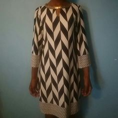 Mod Chevron Dress Only worn 1x.   No imperfections except the gold collar on right side is coming off but can be sewn down or pinned . Gorgeous dress for layering or worn alone. Dresses Mini