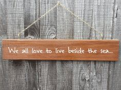 Wooden handpainted 'We all love to live beside the by MakeMemento, £30.00