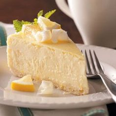 Lemony White Chocolate Cheesecake Recipe -Although it takes some time to prepare this eye-catching cheesecake, the combination of tangy lemon and rich white chocolate is hard to beat. It's always a hit! —Marlene Schollenberger, Bloomington, Indiana