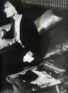 Gabrielle 'Coco' Chanel (71) - 1954 - At home wearing Jersey Suit