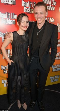 All smiles: Lily Collins and her boyfriend Jamie Campbell Bower looked happier than ever a...