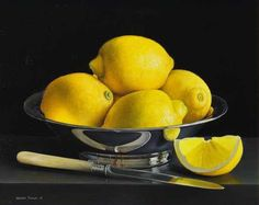 Still life with lemons in a silver bowl and lemon quarter