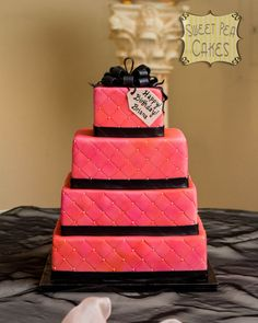 Four tiere quilted fondant cake airbrushed in pink and peach.