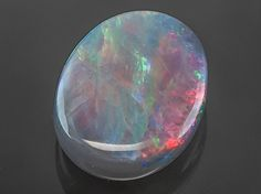 Meet your new favorite Black Opal Oval Cabochon JTV offers exceptional quality and value with this piece. Dark Backgrounds, Colorful Backgrounds, Like A Storm, Rocks And Minerals, Crystals Minerals, Broken Chain, Black Opal, Creature Design, Painted Rocks