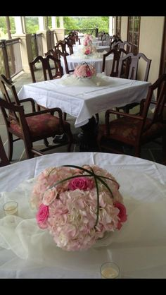Hydrangeas and roses wrapped in lily grass