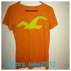 Hollister orange and yellow top Size large, worn once. No signs of wear. Super soft material. Please use the bundle feature if interested in a discount or the offer button for single items. No holds and no trades.  Hollister Tops Tees - Short Sleeve