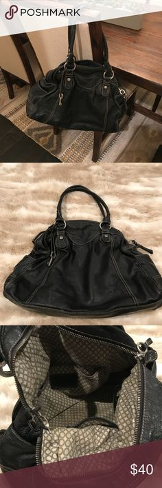 Fossil Bag Black CALLING ALL BAG COLLECTORS! Rare! Retired! Quality leather and hand brushed nickel hardware! Fabulous bag in great condition. 👜 Missing one piece of hardware on one side (see picture). Priced accordingly!   ⚡️⚡️⚡️  Stored in smoke-free, pet-free home. Items packaged with love and shipped quickly every time! 💘 Fossil Bags Totes