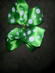 Small green with white polka dot bow